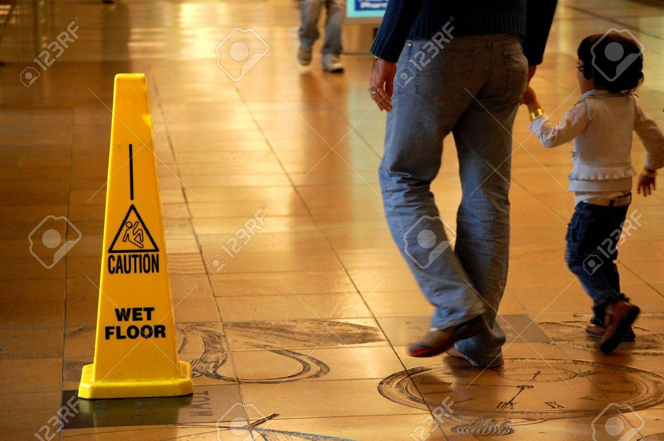 Caution Wet Floor sign in a shopping mall Stock Photo - 5225656