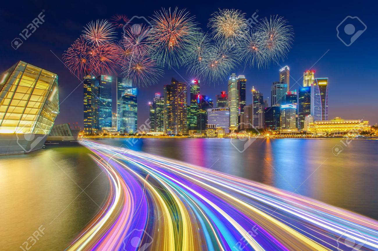 Landscape of the Singapore financial district and business building with speed light on the river in Singapore national day fireworks celebration. - 58068322