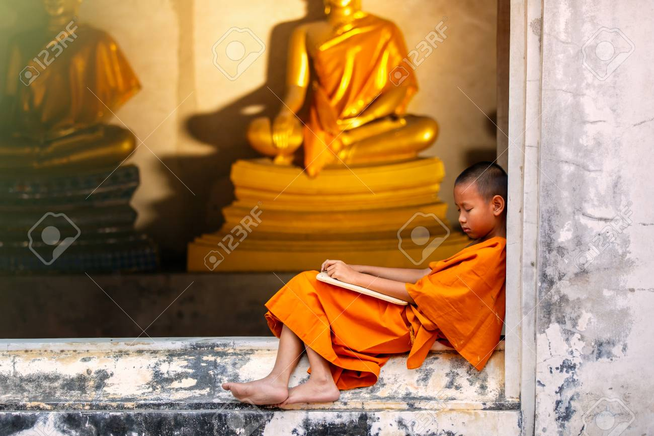 Novice sleeping on the terrace after hard study discipline outside of The Buddha Status. Temple in Thailand. - 58189793