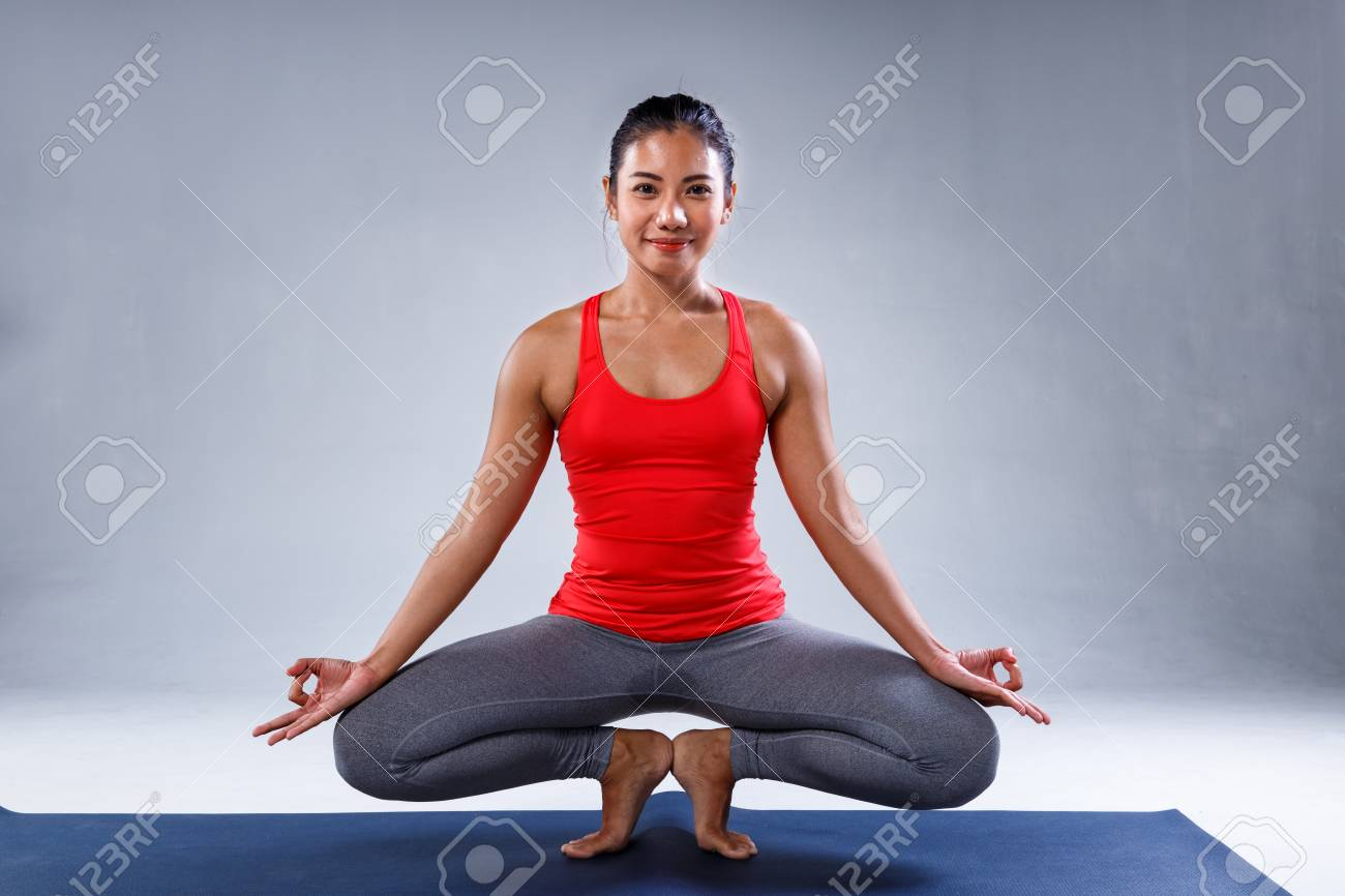 Yoga Concept Pretty Sporty Indian Woman Smiling In Doing Yoga Stock Photo Picture And Royalty Free Image Image 72734985