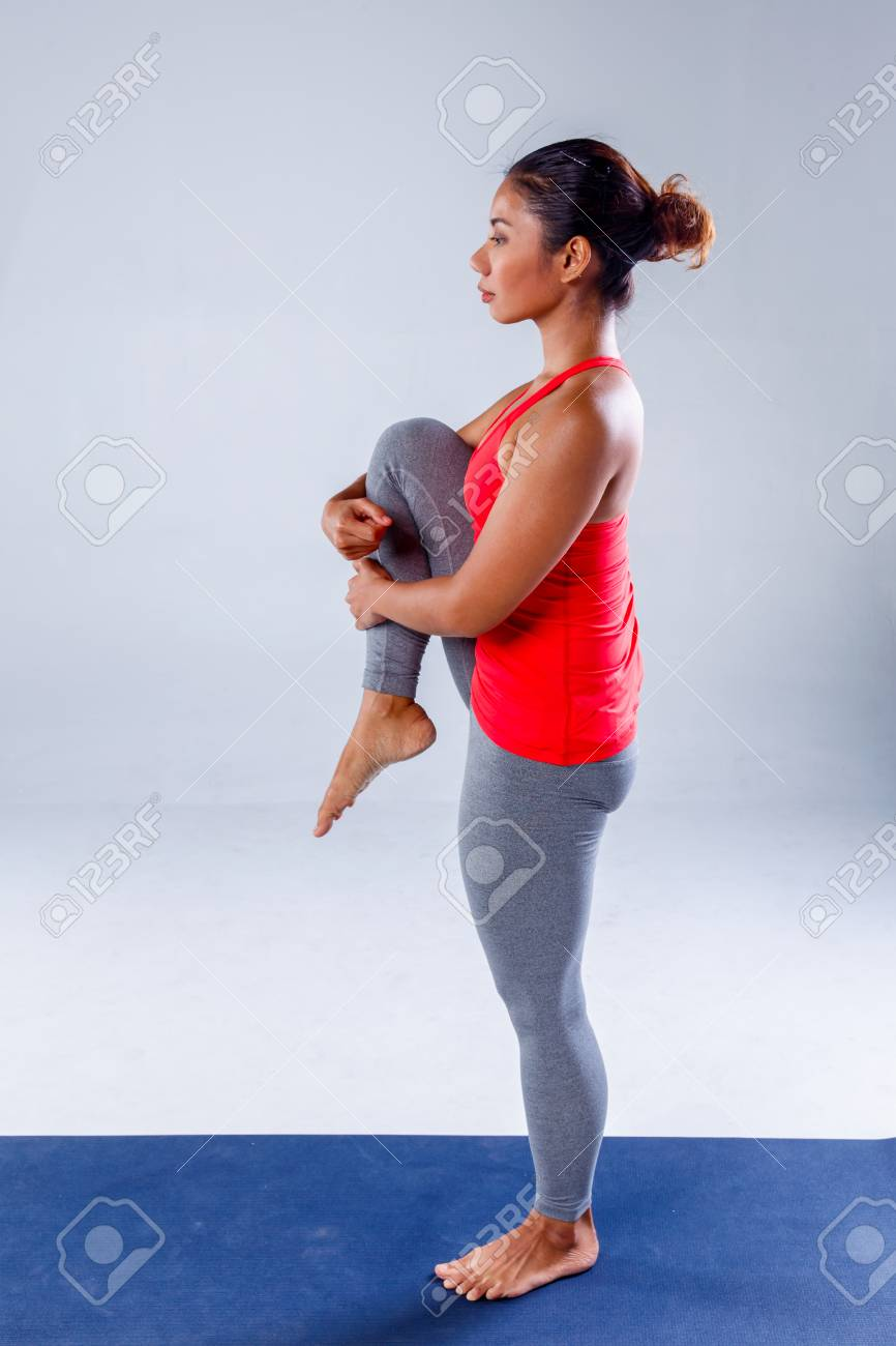 Yoga Concept Pretty Sporty Indian Woman Smiling In Doing Yoga Stock Photo Picture And Royalty Free Image Image 80699755