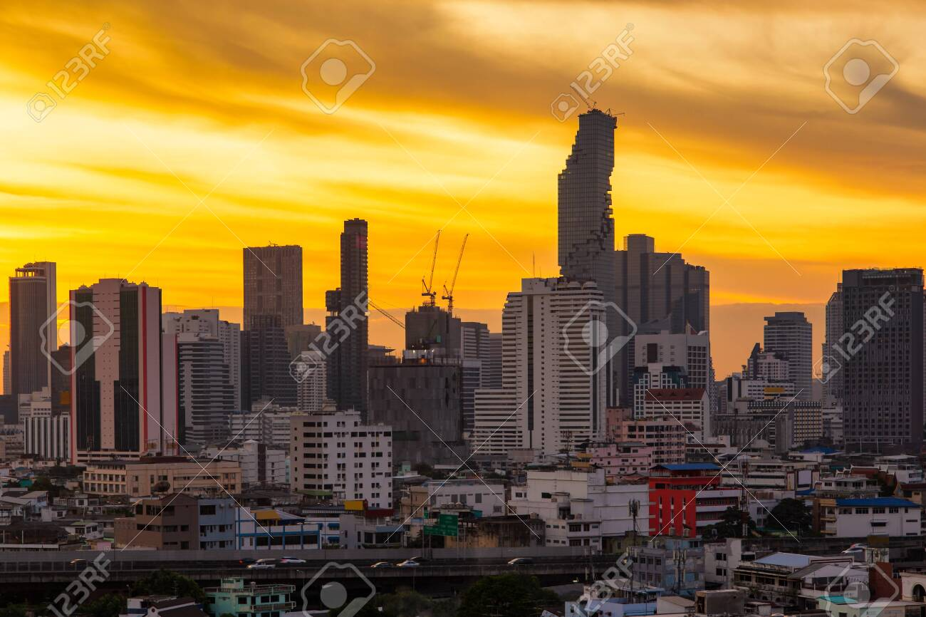 Aerial view modern office buildings in Bangkok city downtown with sunrise time, Bangkok Province, Thailand - 148551570