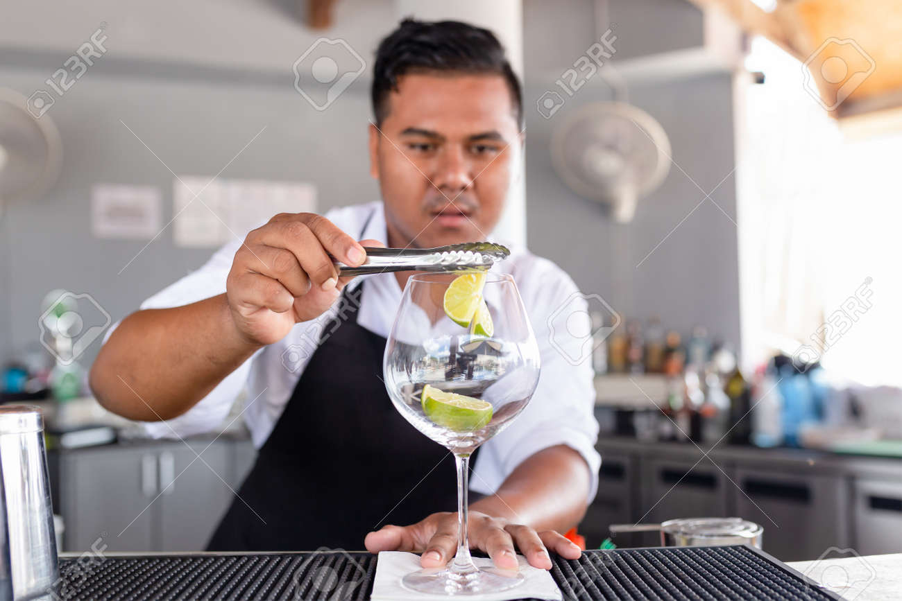 Bartender is making cocktail at counter bar. - 167505862