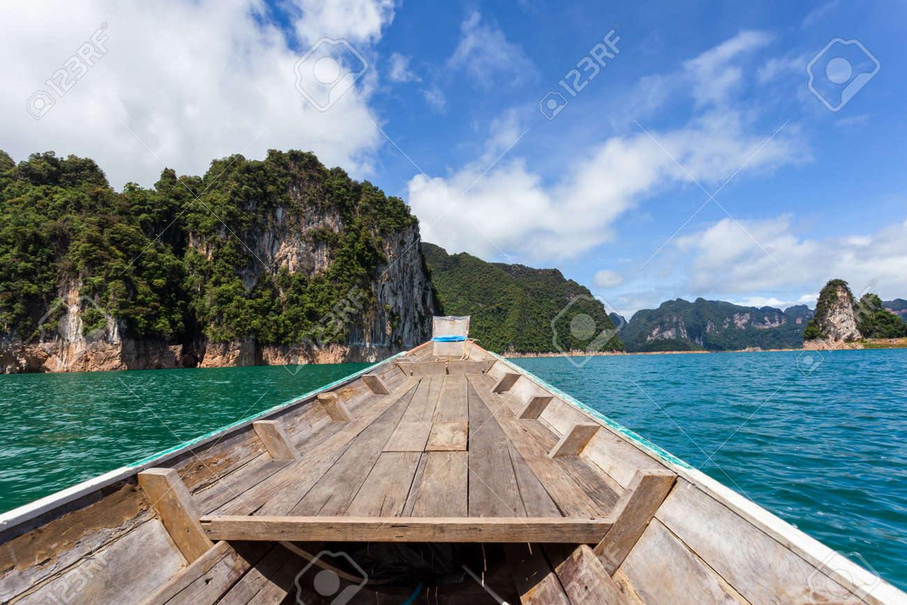 Traditional longtail boat with beautiful scenery view in Ratchaprapha Dam at Khao Sok National Park, Surat Thani Province, Thailand. - 167505895