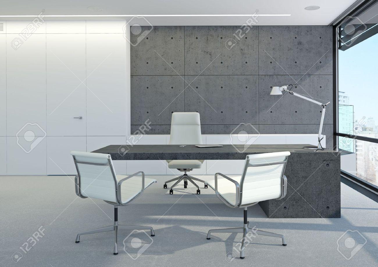 Un bureau moderne blanc avec des murs en béton banque dimages et