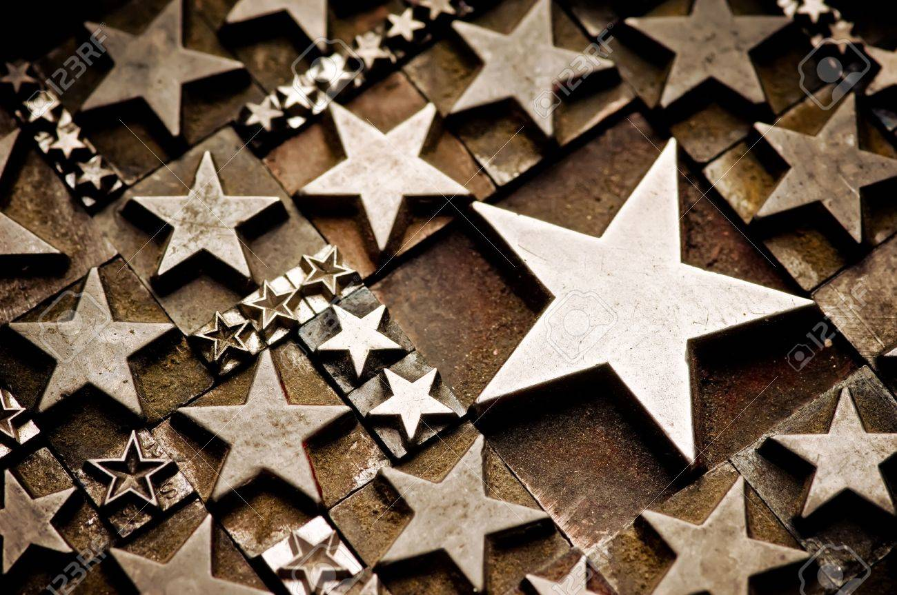 A random arrangement of letterpress stars with narrow depth of field. Part of a series of letterpress backgrounds Stock Photo - 3440601