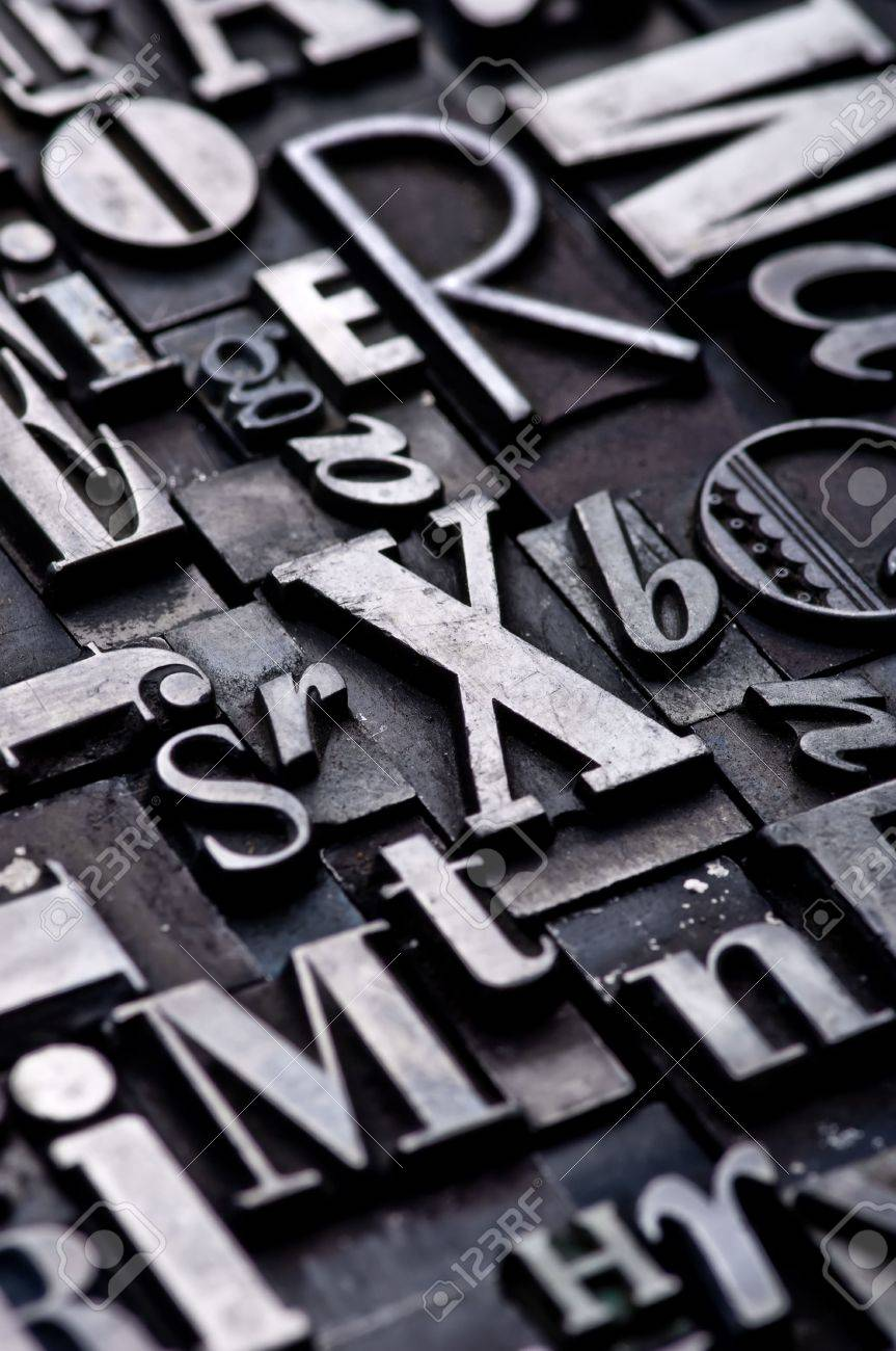 A random arrangement of letterpress letters with narrow depth of field. Part of a series of letterpress backgrounds Stock Photo - 3593513