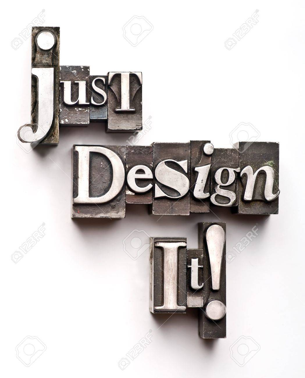 The phrase Just Design It done in vintage letterpress type Stock Photo - 4065990