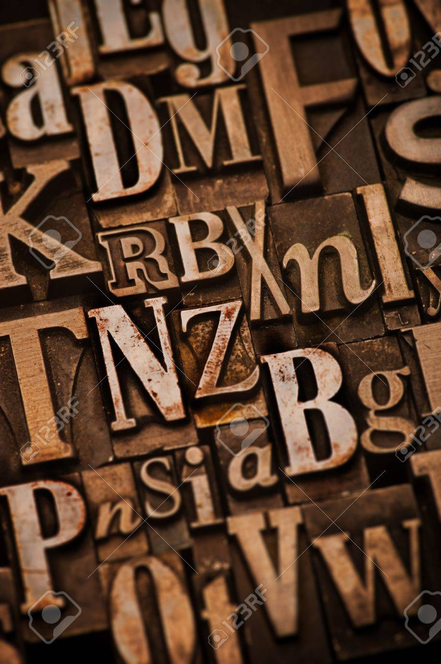 A randon arrangement of letterpress letters with narrow depth of field. Part of a series of letterpress backgrounds Stock Photo - 4066016