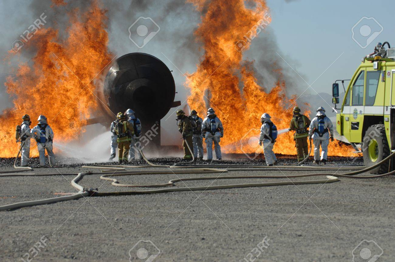 Firefighters train for battling an aircraft fire Stock Photo - 4137587