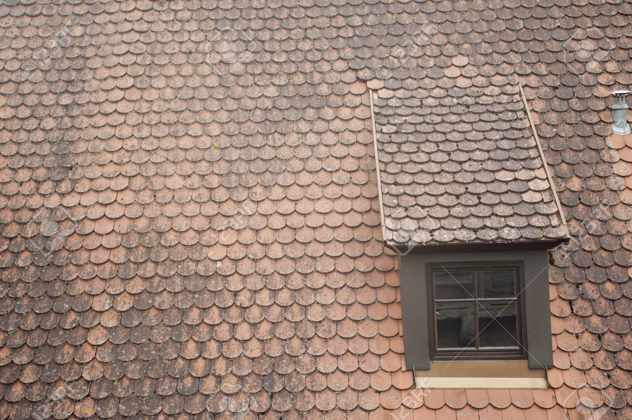 antique window on roof in Germany. Stock Photo - 13885540