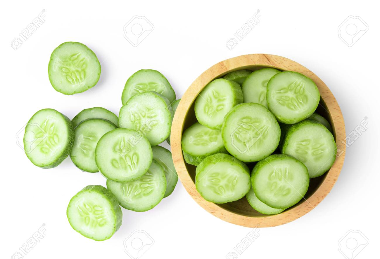 Fresh cucumber slices isolated on white background. top view - 136593002