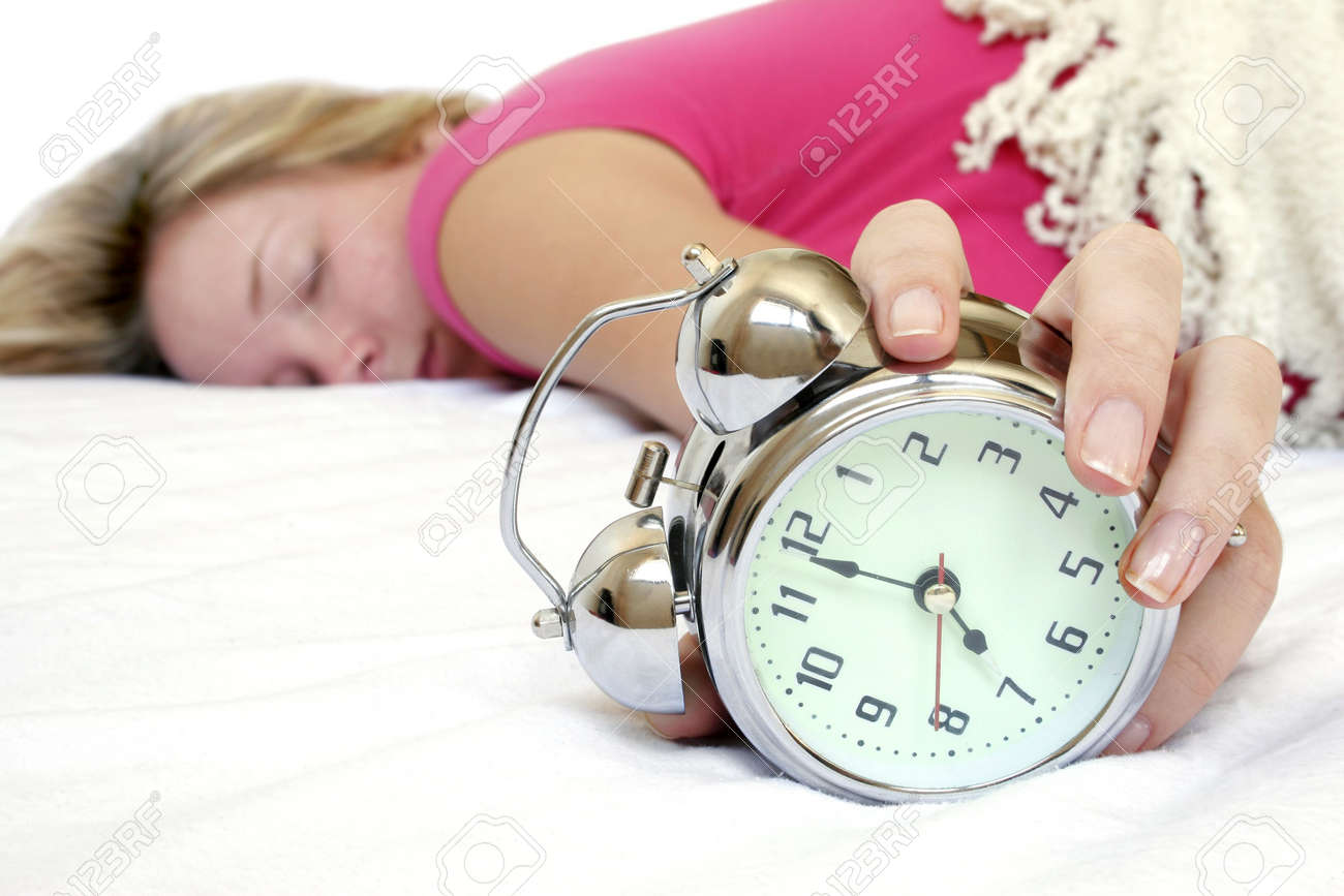 Woman and alarm clock in bed Stock Photo - 345067