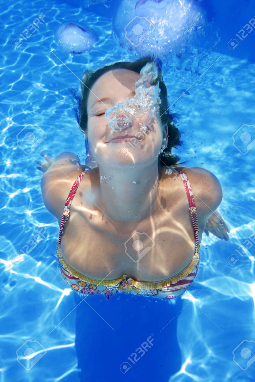 Woman in bikini underwater in bright blue pool Stock Photo - 1397525