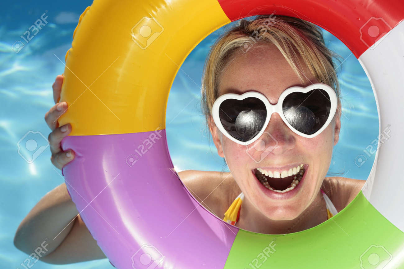 Laughing woman with sunglasses and inflatable toy Stock Photo - 5075406