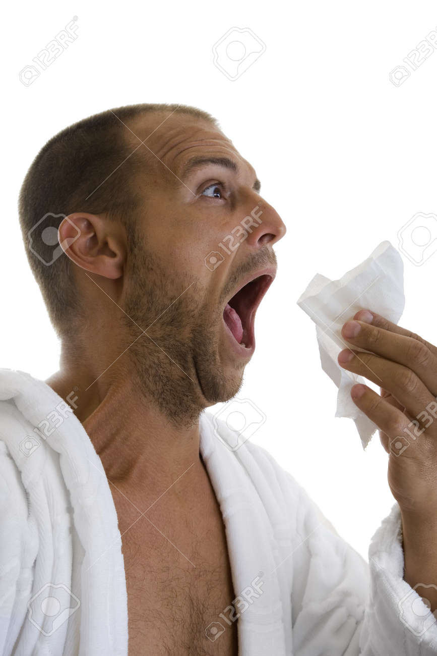 Man in a white bathrobe sneezing into a hankie Stock Photo - 5694358