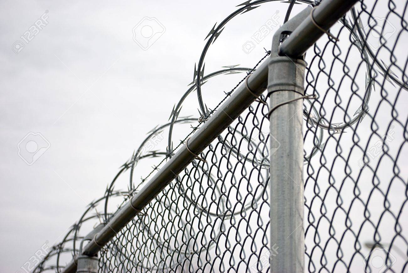 Chain Link Fence With Razor Wire On Top Stock Photo, Picture And ...