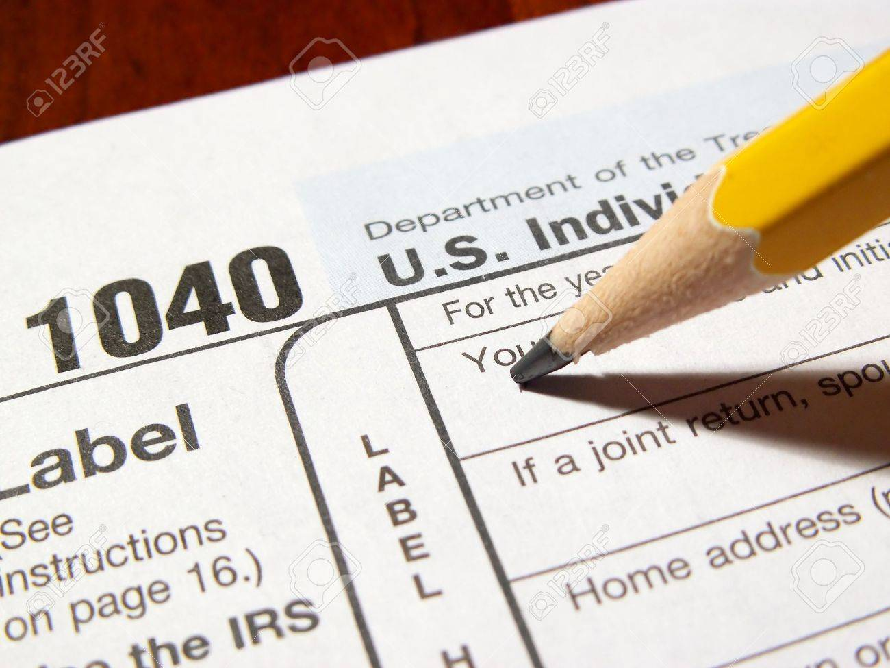 Pencil Completing 1040 Income Tax Form Photo Picture And – Tax Form