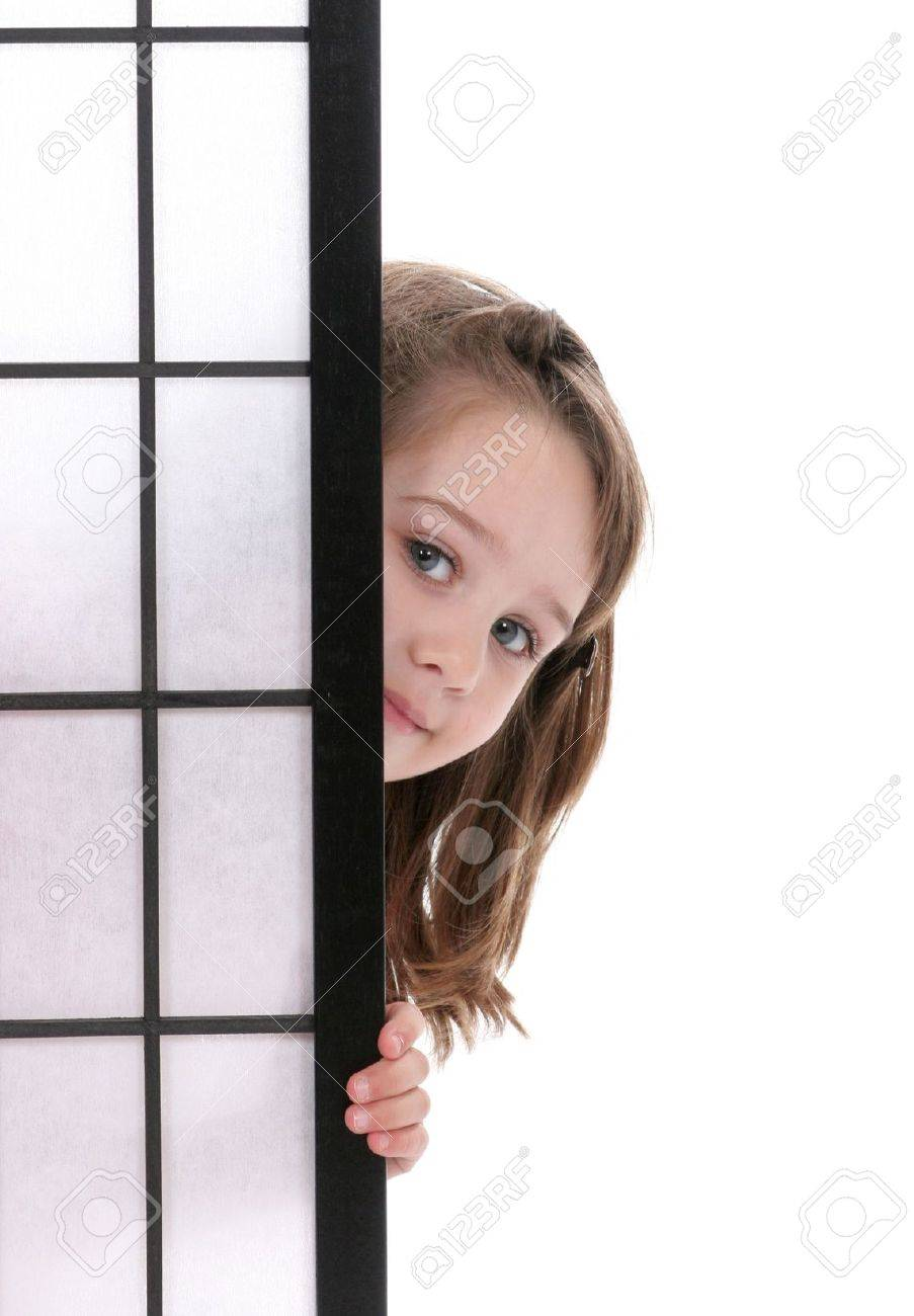 Pretty Little girl peeking out from behind a screen. Stock Photo - 3014401