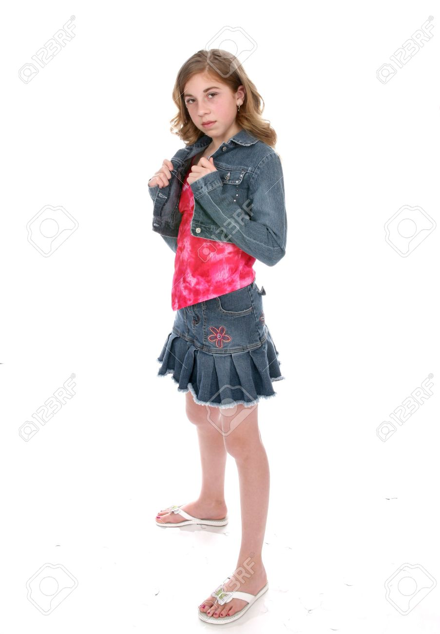 Defiant Looking Young Girl Wearing A Short Denim Mini Skirt And ...