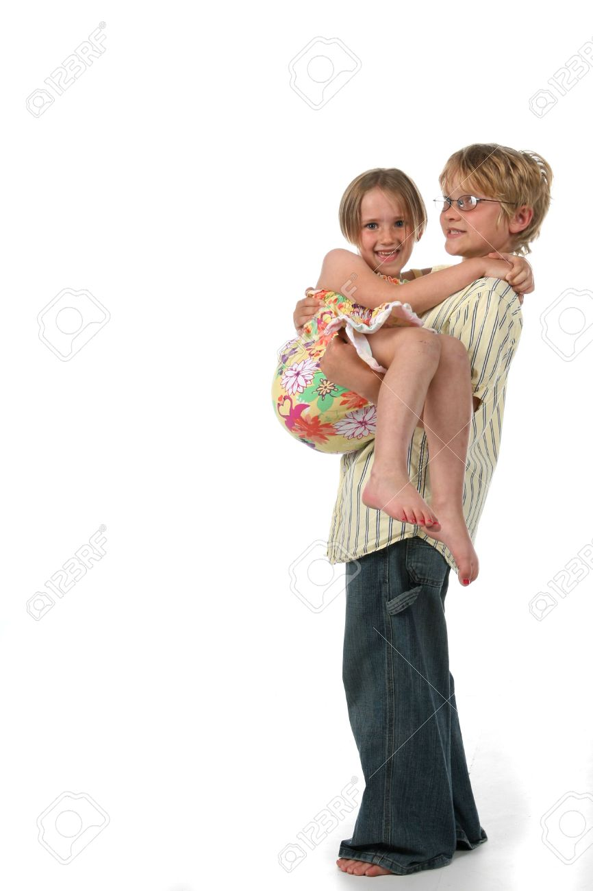 Big brother holding his little sister in his arms and carrying her Stock Photo - 3227435