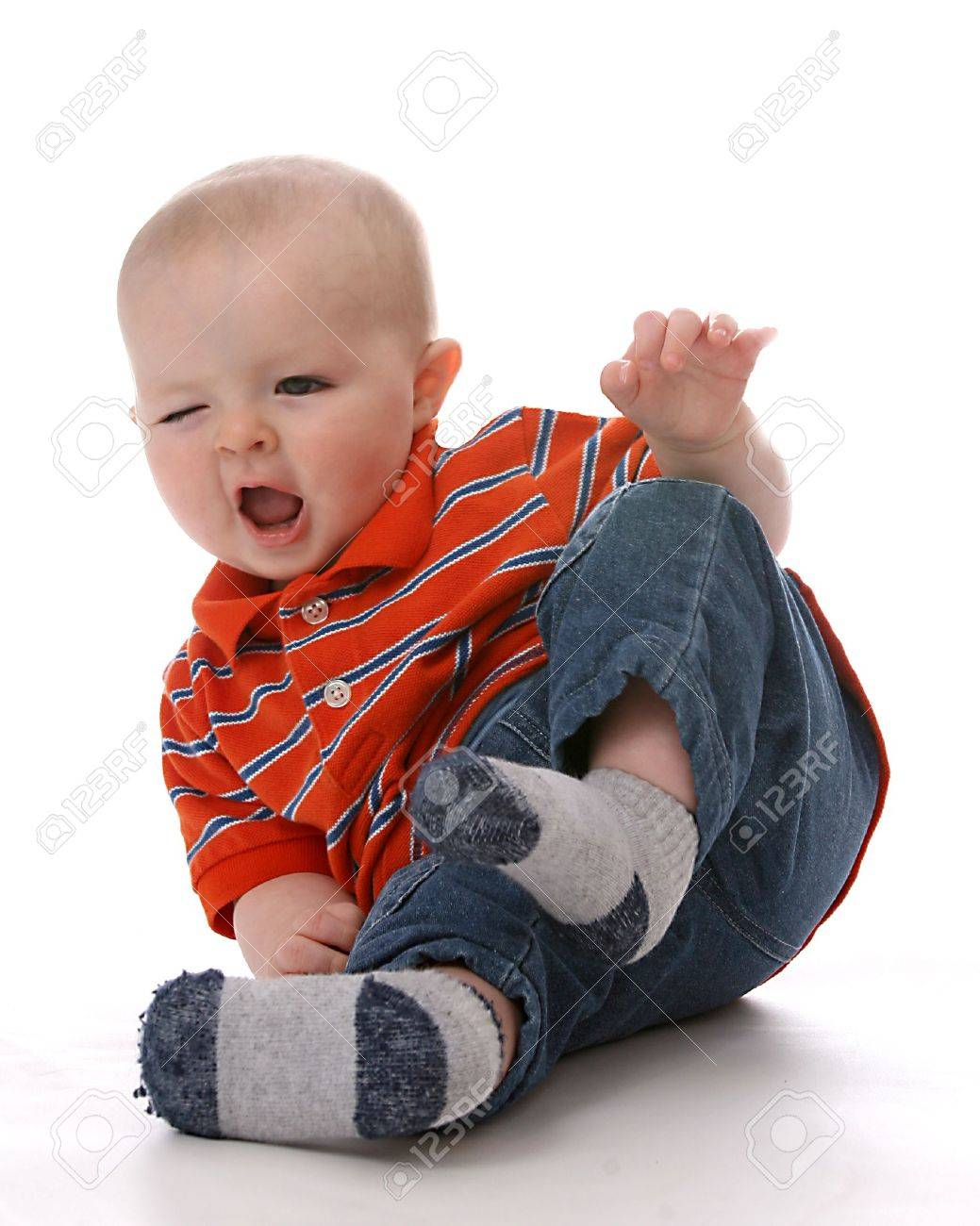 Funny Baby Boy Tipping Bottom In Air And Making A Cute Face Stock ...