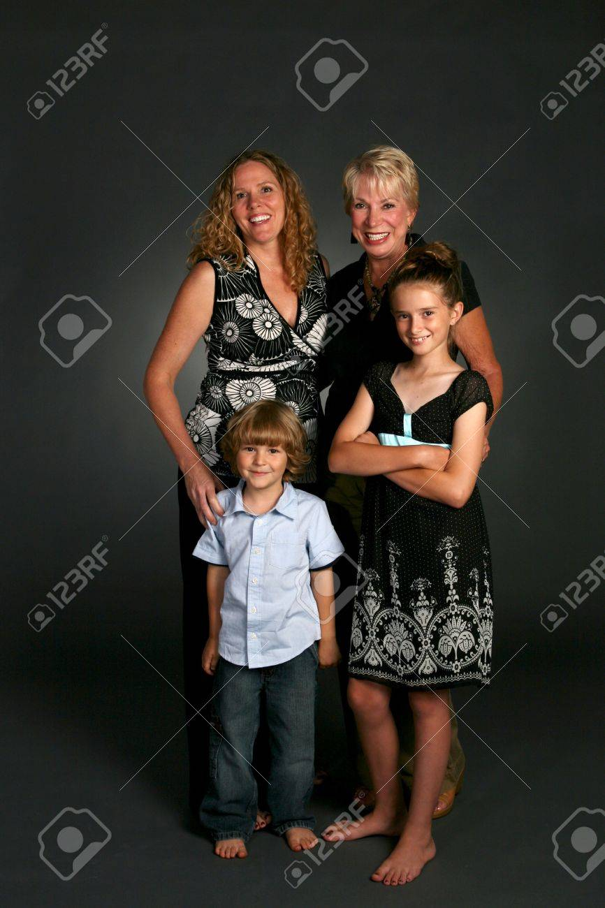 attractive family together in studio portrait Stock Photo - 3434198