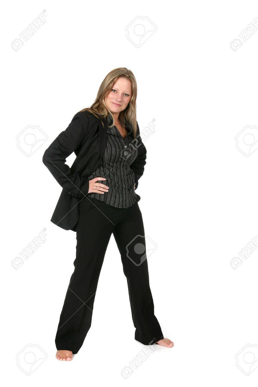 professional woman in black with legs spread out stock photo