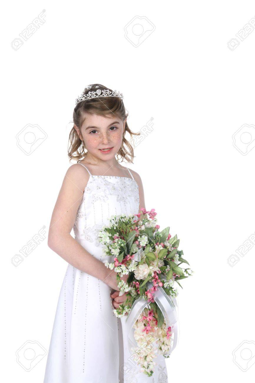 Pretty Little Girl In White Gown Tiara And Holding A Bouquet