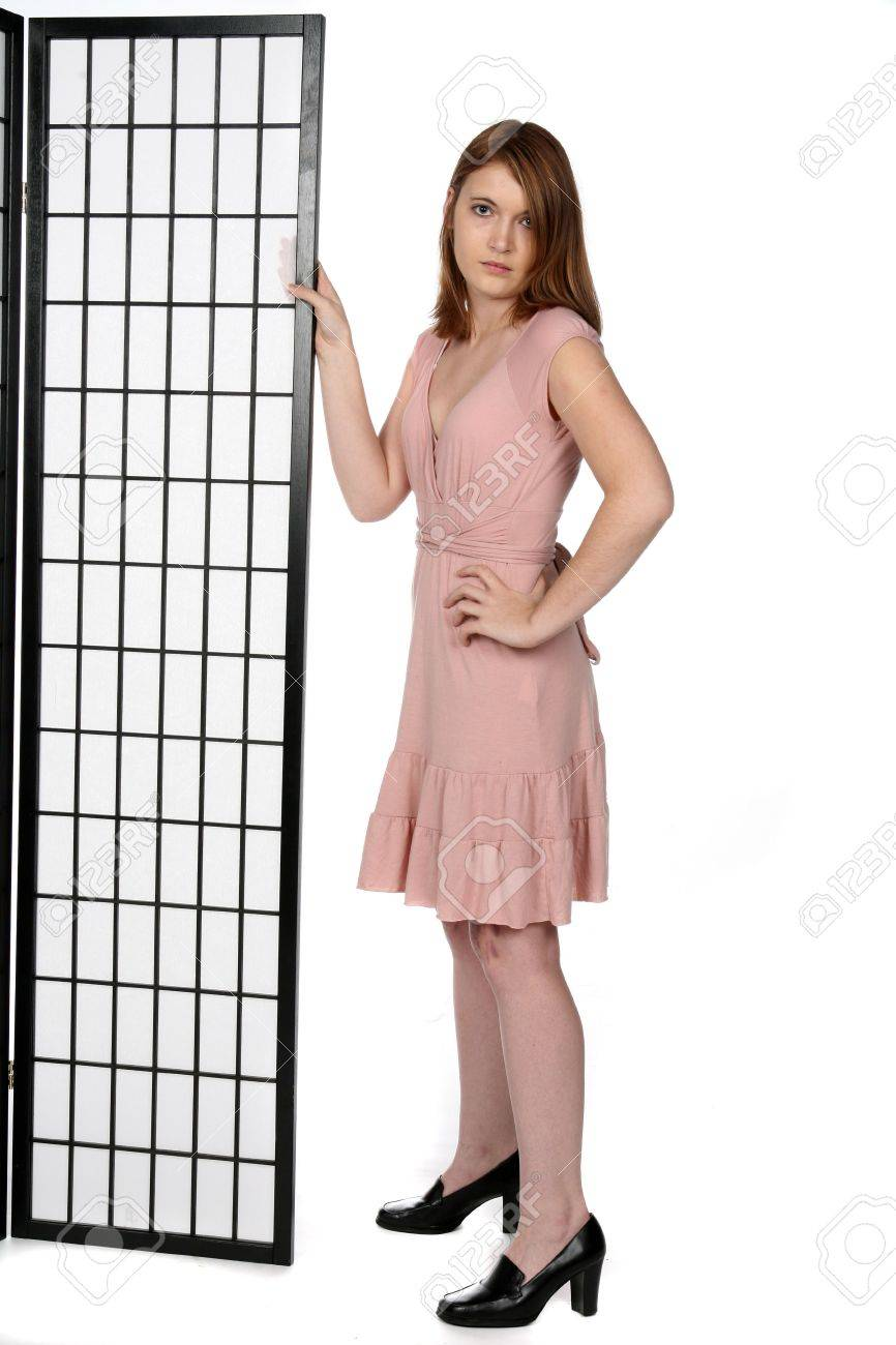 Pretty Teen In Black Shoes And Pink Dress Next To Screen Stock ...