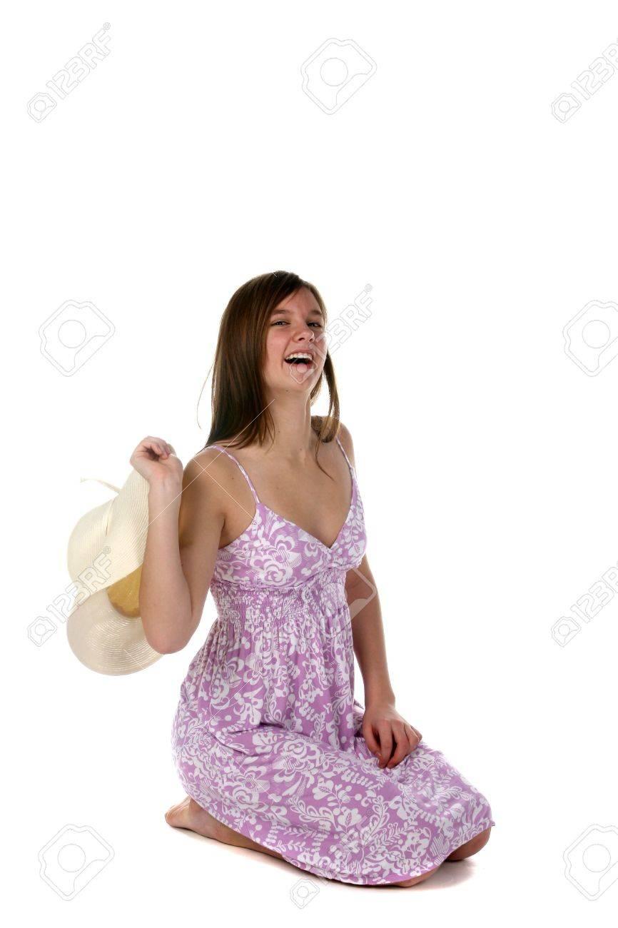 Pretty Kneeling Teenage Girl In Purple Sundress Stock Photo ...