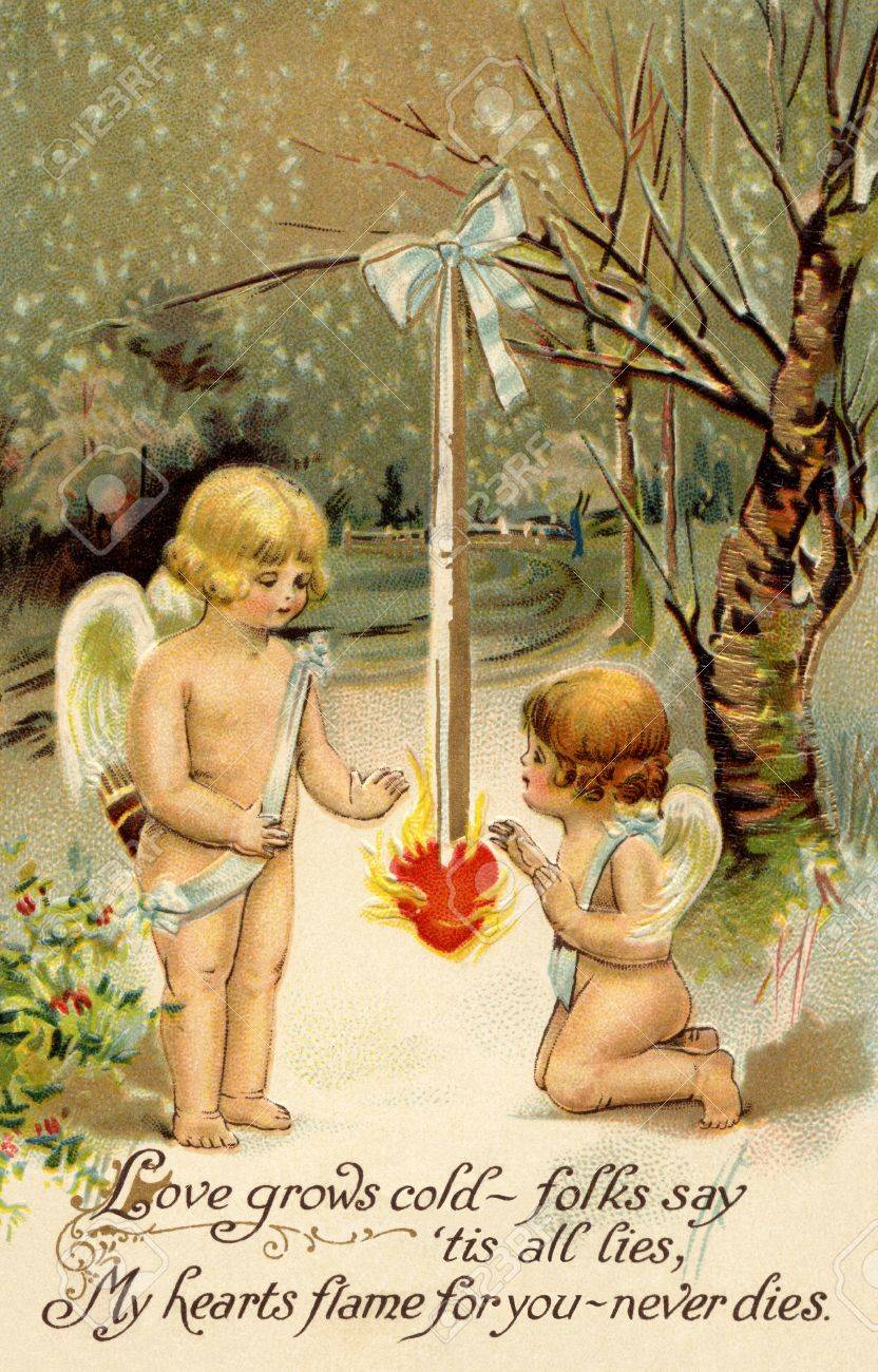 A vintage Valentine card with two cherubs warming up next to a heart on fire Stock Photo - 14916393
