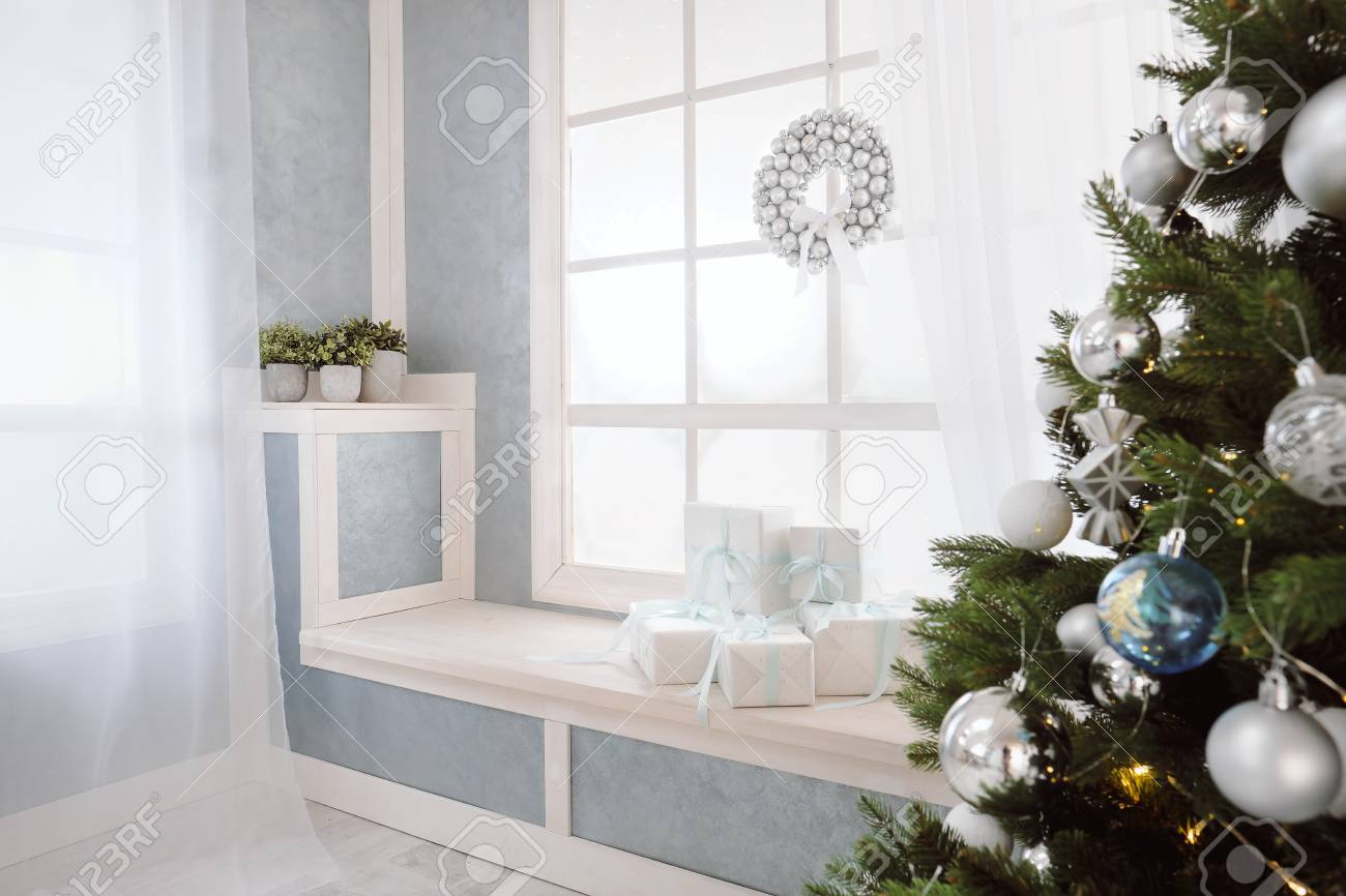 bright interior window with curtains white window sill christmas tree window and