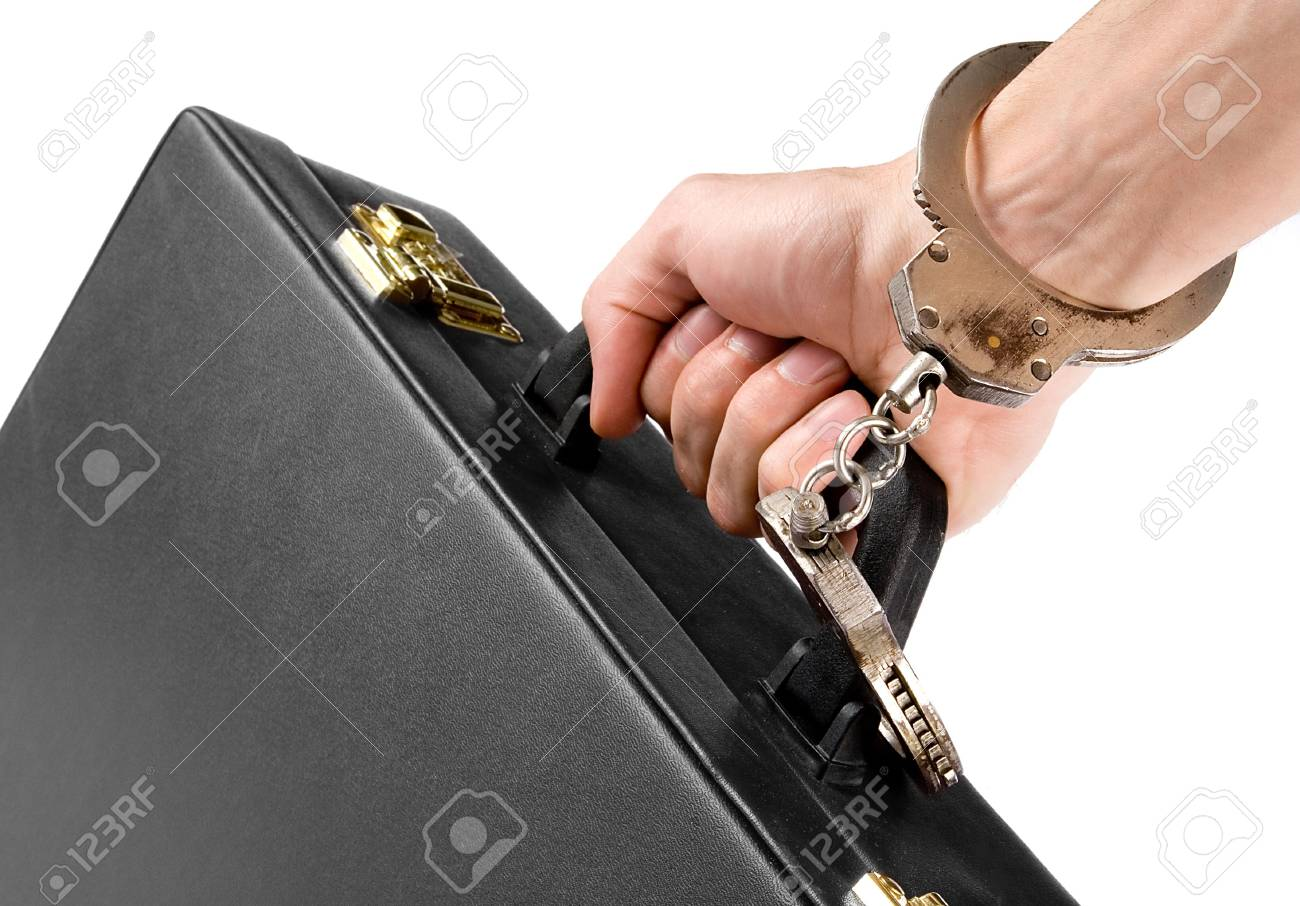 Hand on handcuffs with a briefcase Stock Photo - 5339565