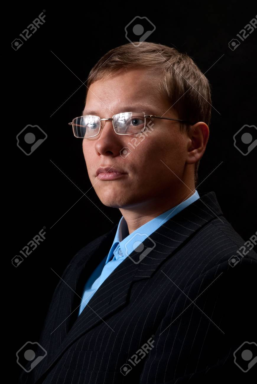 Thinking young businessman about something Stock Photo - 5724112
