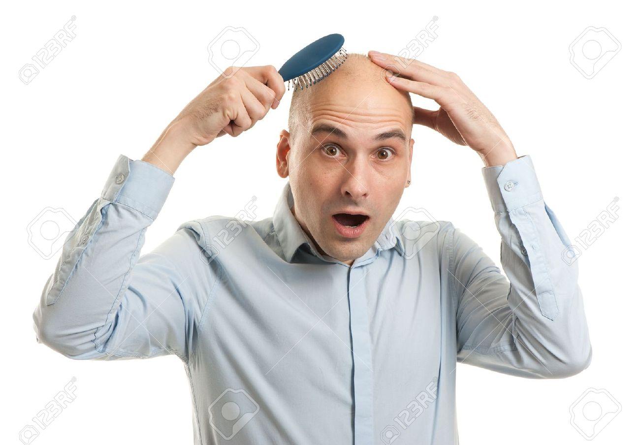 Shocked bald man holding comb - 16763121