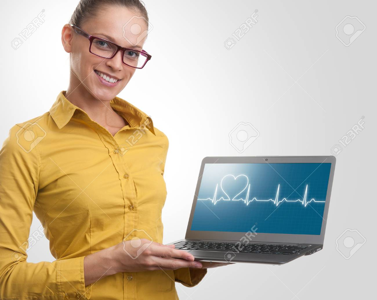 beautiful woman showing a laptop. Health care concept Stock Photo - 22350124