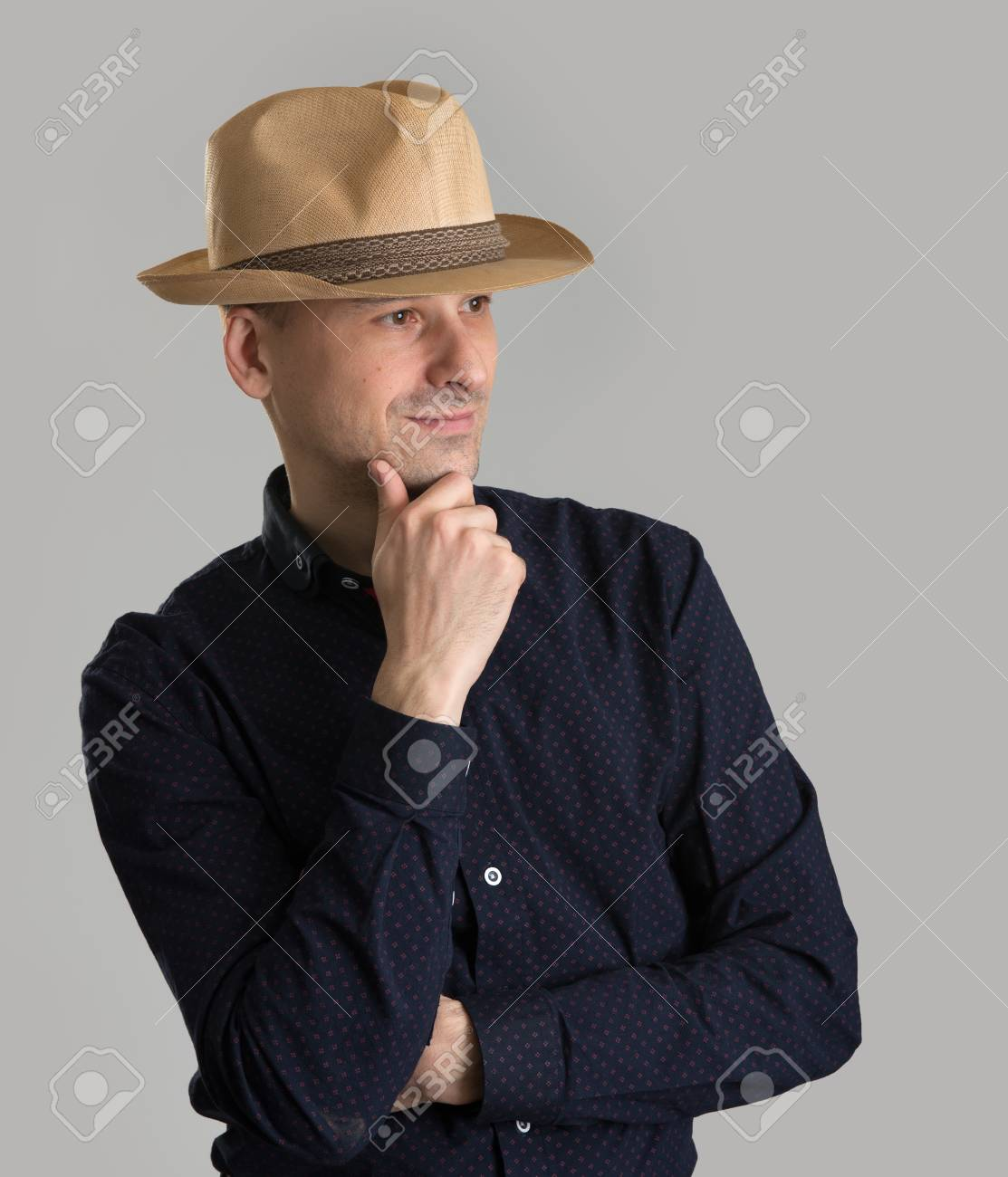 smiling man wearing fedora hat isolated over grey Stock Photo - 48205822 c7dbf74bf6c3