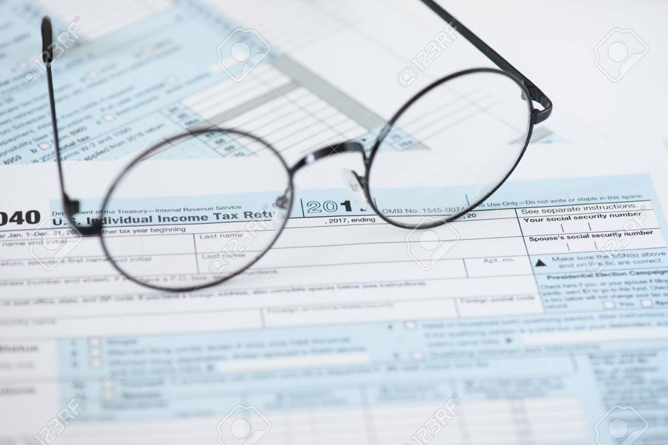 US tax form and glasses  Finance concept background