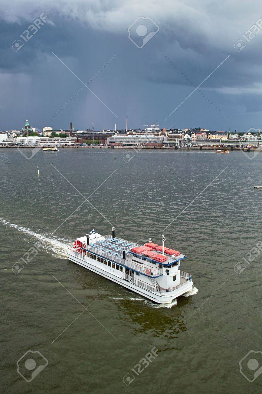 Small passage-catamaran in Helsinki harbor Stock Photo - 7151235