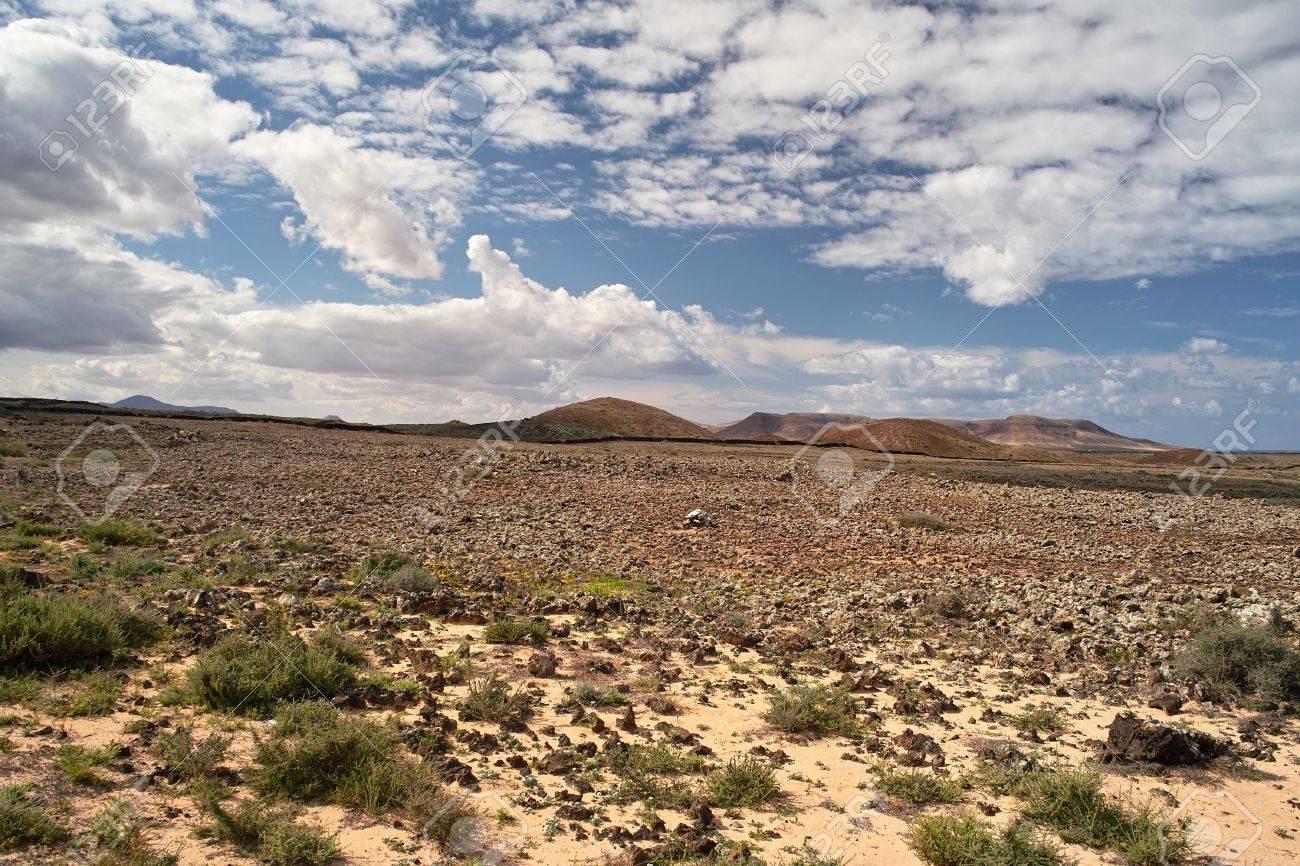 Stony desert and volcanic hills on Fuerteventura island, The Canaries Stock Photo - 9688217
