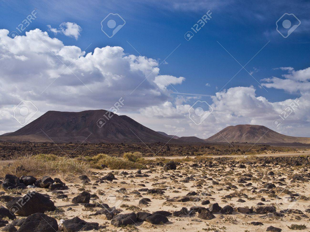 Stony desert and volcanic hills under dramatical cloudy sky Stock Photo - 9688228
