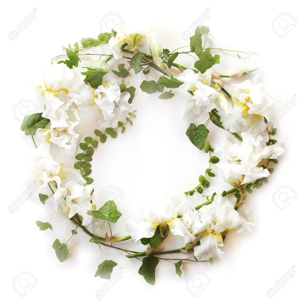 Round Floral Frame Made Of Fresh Iris White Flowers And Ivy Hedera