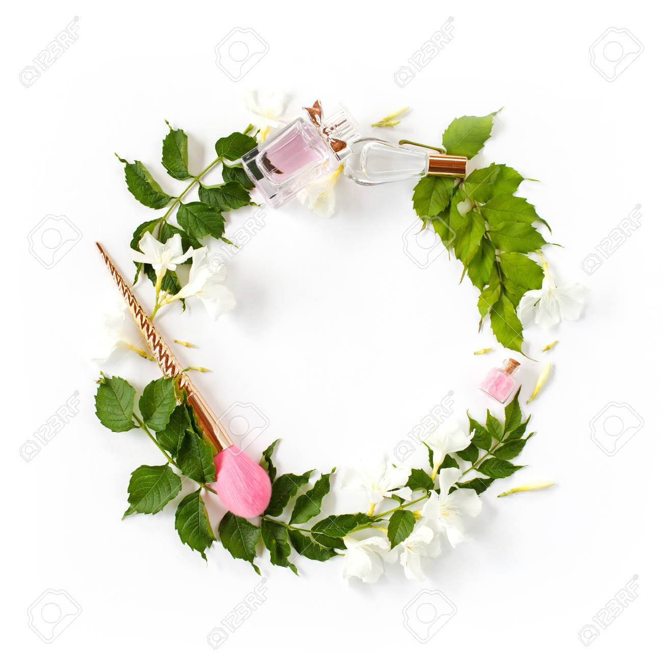 Flowers and beauty accessories composition wreath made of bright flowers and beauty accessories composition wreath made of bright green leaves white flowers mightylinksfo
