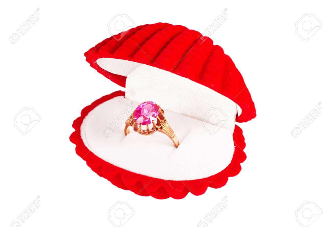 A red seashell box with golden ring Stock Photo - 7209807