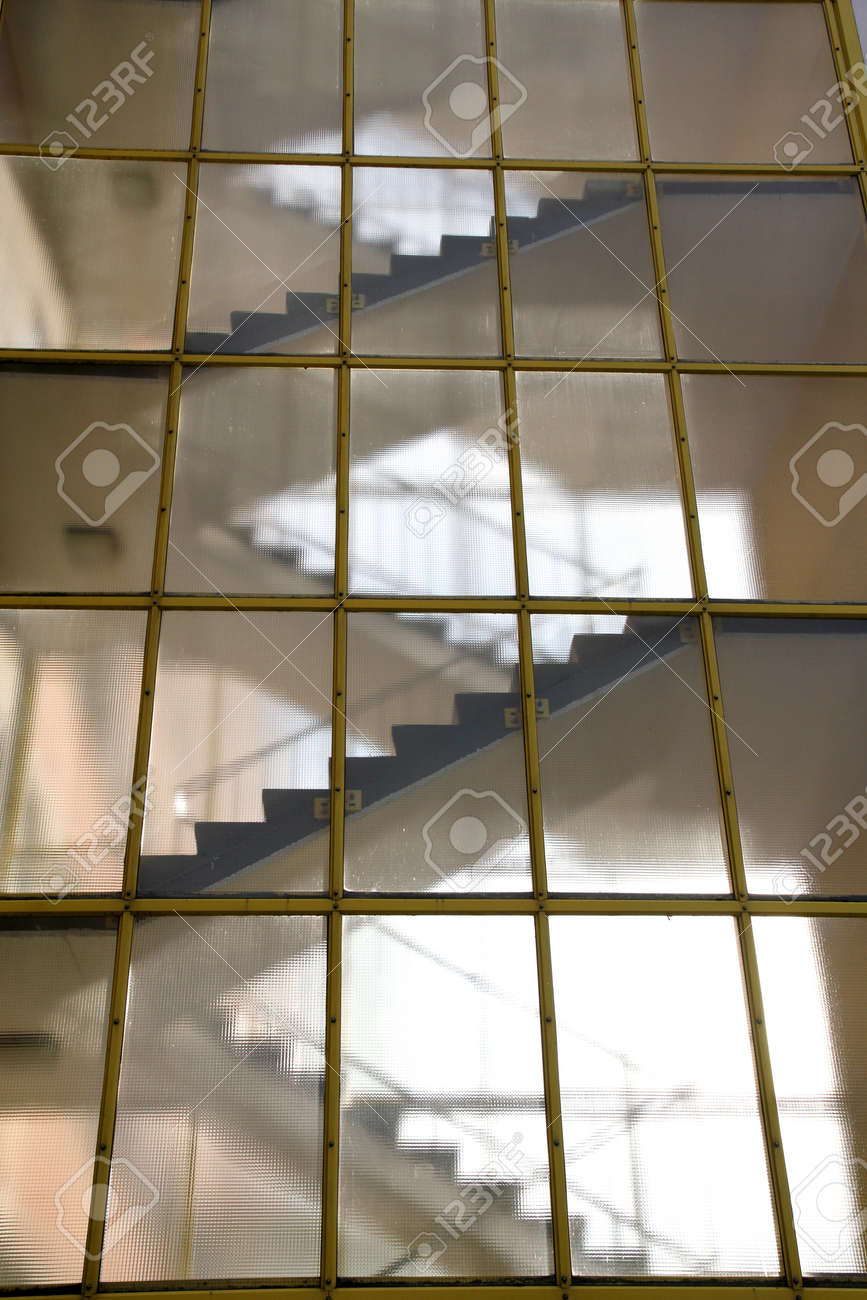 Modern Architecture Detail stairs behind a glass wall modern architecture detail stock photo