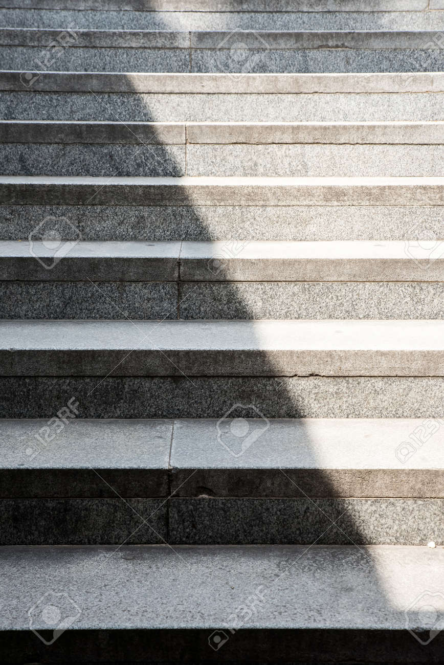 Concrete Stairs Background With A Shadow Covering Half. Stock Photo    44473660