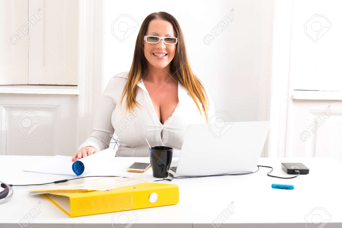 Big and Beautiful Secretary working in a office - 107003131