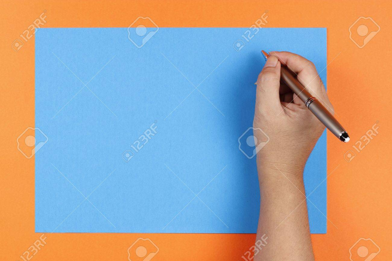 A Womans Hand Holding A Pen Writing On Colored Blue Paper On – Colored Writing Paper