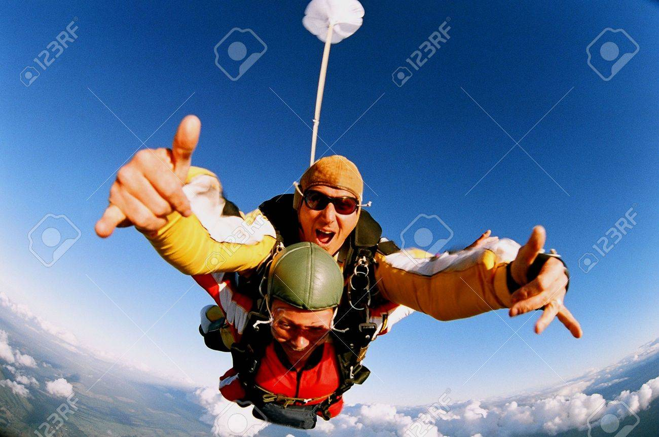Two people skydiving in tandem from an aeroplane. Stock Photo - 2045114